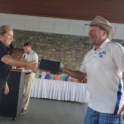 Golfer accepting award